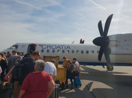 Propeller Plane to Split